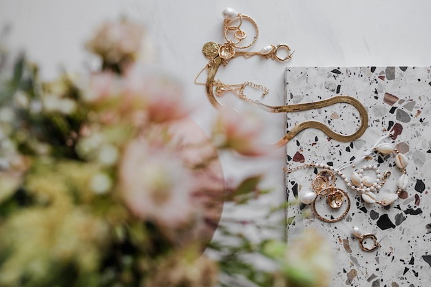 Gold jewelries with a flower bouquet