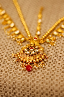 Gold jewelry in box , necklace