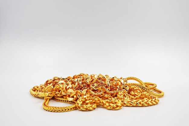 Gold jewelry on white background