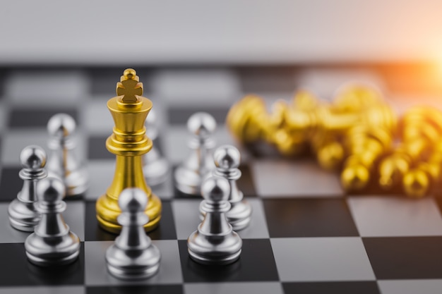 Gold king in chess game, business victory or decision the path to success.