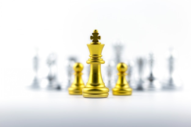 Gold king in chess game with concept for company strategy.