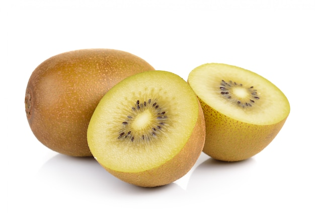 Gold kiwi fruit on a white wall