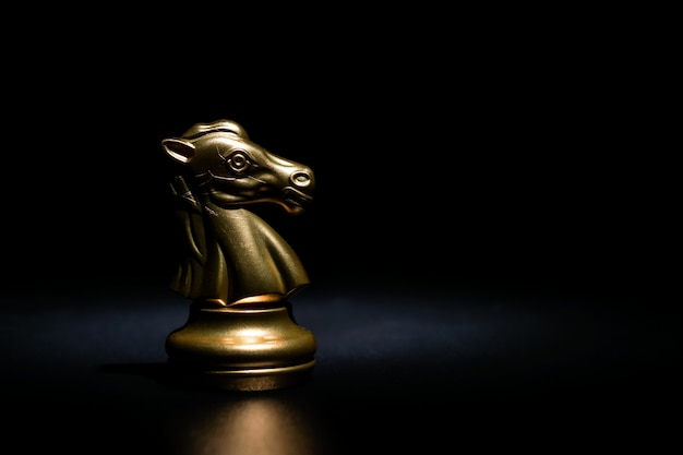 Gold knight chess on black background