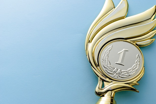 Gold medallion winners trophy with laurel wreath