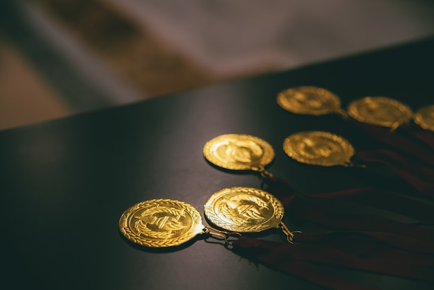 Gold medals for successful people in business who manage to reach their goals with effort.