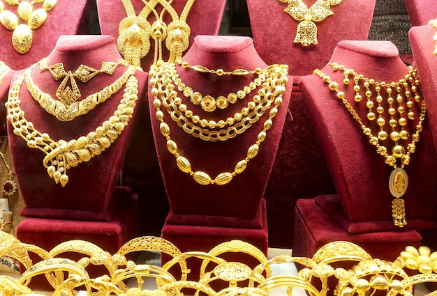 Gold necklaces and chains on stands