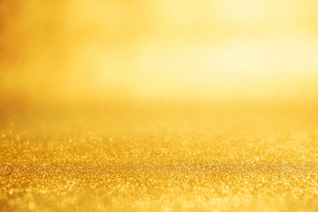 Gold new year background abstract, yellow glitter bokeh vintage lights, defocused.