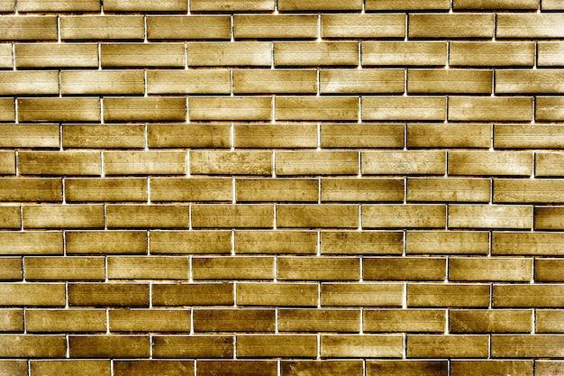 テクスチャード加工された金色のレンガの壁