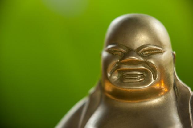 Золото окрашены смеющийся будда статуэтка