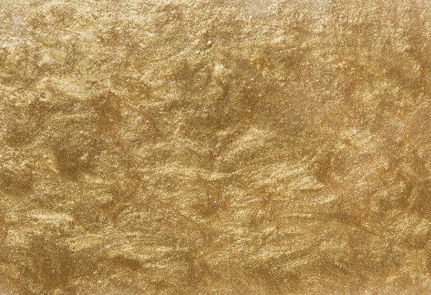 Gold painted textured wall background