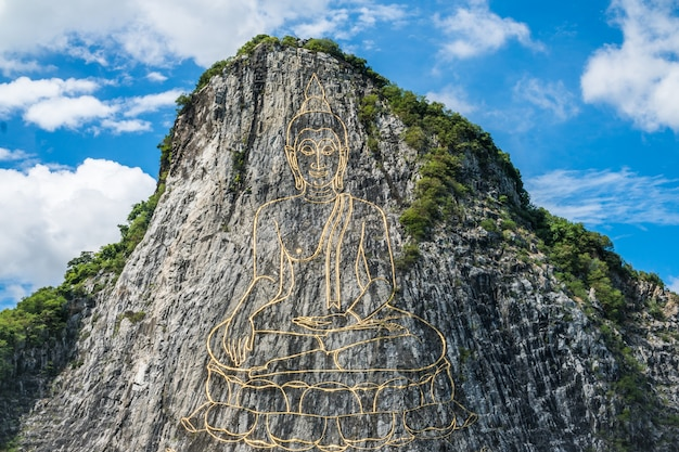 Gold painting of buddha statue on cliff at cheechan mountain