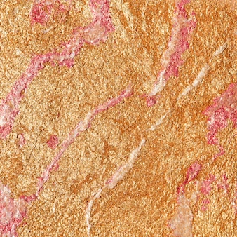Gold and pink shiny textured paper background
