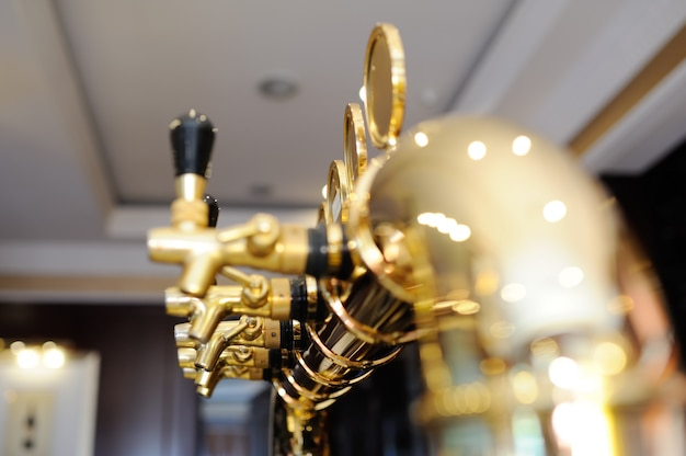Gold plated beer tap for dispensing beer closeup