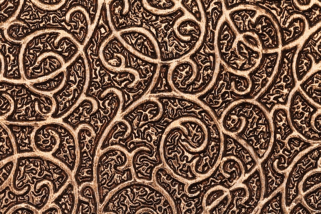 Gold plated metallic textured background with patterns.