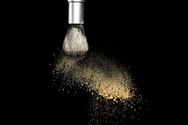 Gold powder explosion black background