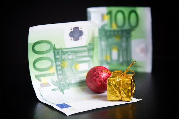 Gold present, christmas decorations and euros