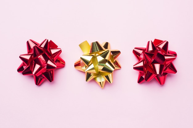 Gold and red christmas bows. gift concept greetings for birthday