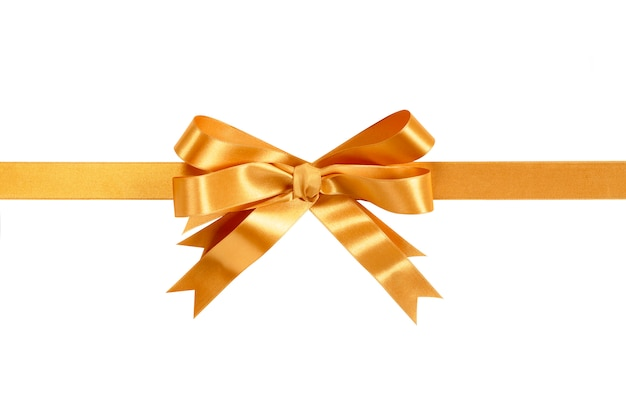Gold ribbon and bow isolated against white.