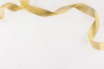 Gold ribbon on light table