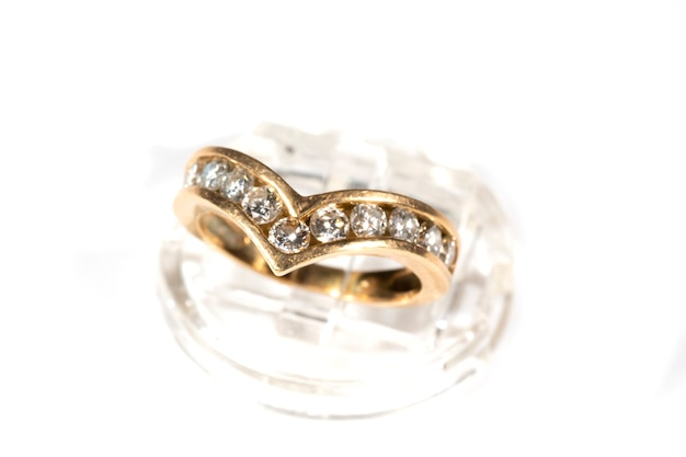 Gold ring with diamonds. the female accessory is isolated on a white background. jewelry as a gift