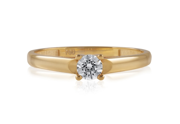 Gold ring with a shiny diamond stone on it