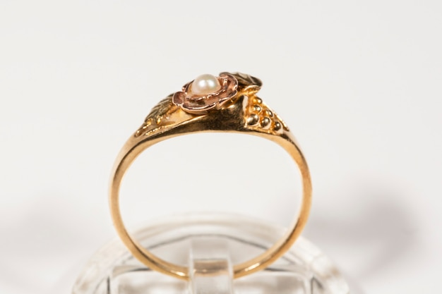 A gold ring with a small pearl. ring model black hills, grape leaves and bunches