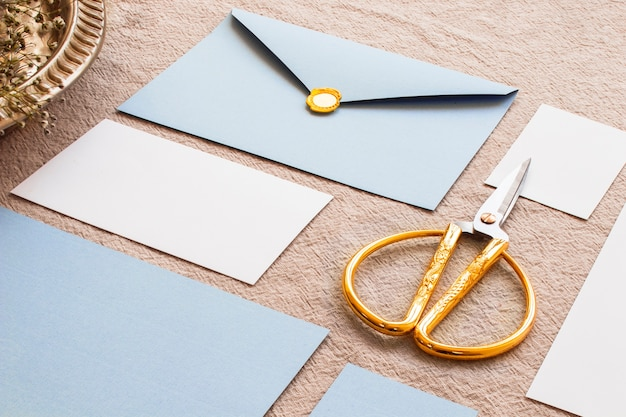 Gold scissors in composition on tablecloth
