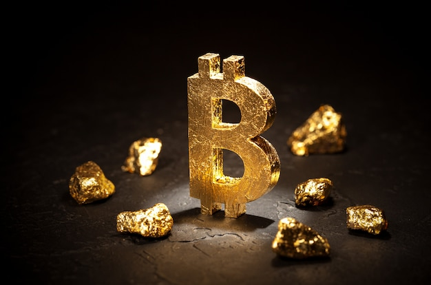 Gold sign bitcoin and gold nuggets