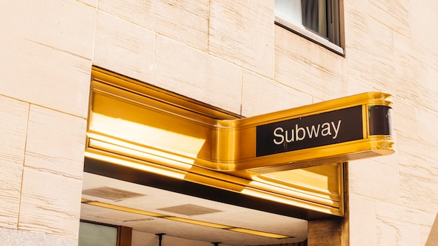 Gold sign board of subway