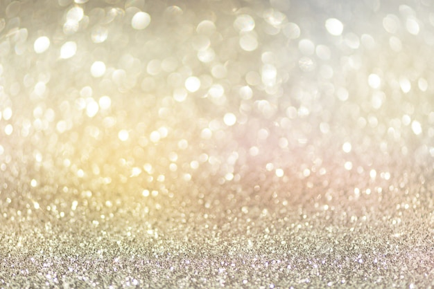 Gold and silver abstract bokeh lights. shiny glitter background with copy space.
