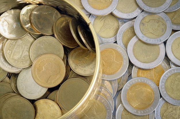 Gold and silver coins one baht in top view
