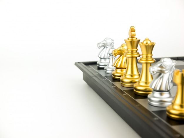 Gold and silver king and knight of chess piece setup on white background