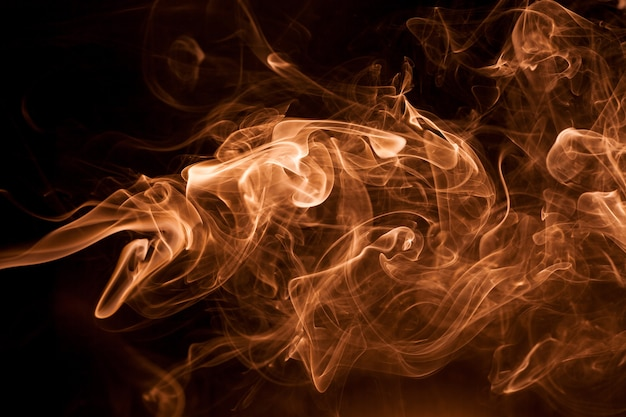 Gold smoke on a black backgroug.