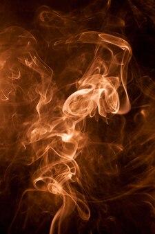 Gold smoke on a black backgroug. Premium Photo
