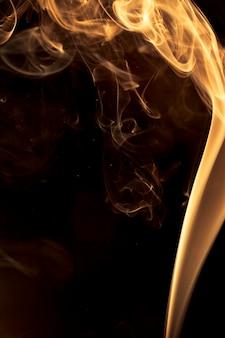 Gold smoke on black background.