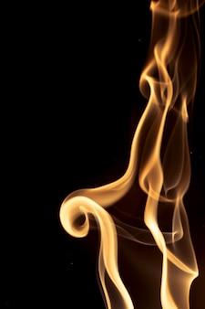 Золотой дым на черном фоне.