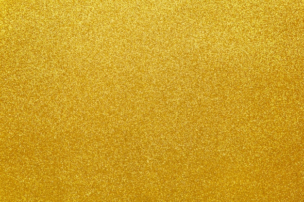 Gold sparkling festive background, close-up
