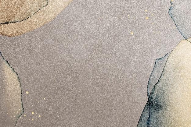 Gold splatter on watercolor background illustration