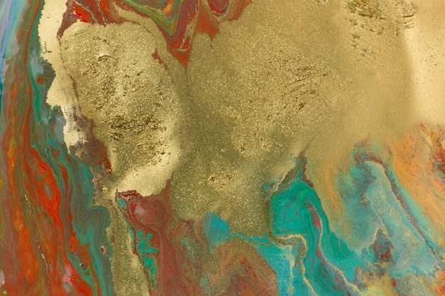 Gold spots on red and blue smudges of paint abstract pattern