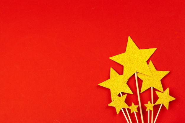 Gold star decoration on red background
