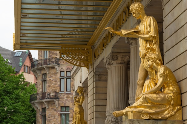 Gold statues at the royal dramatic theatre of sweden