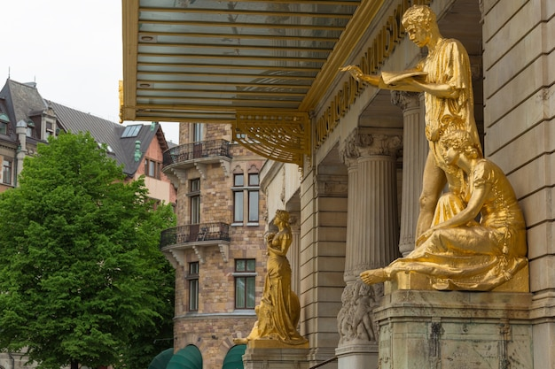 Gold statues at the royal dramatic theatre in sweden