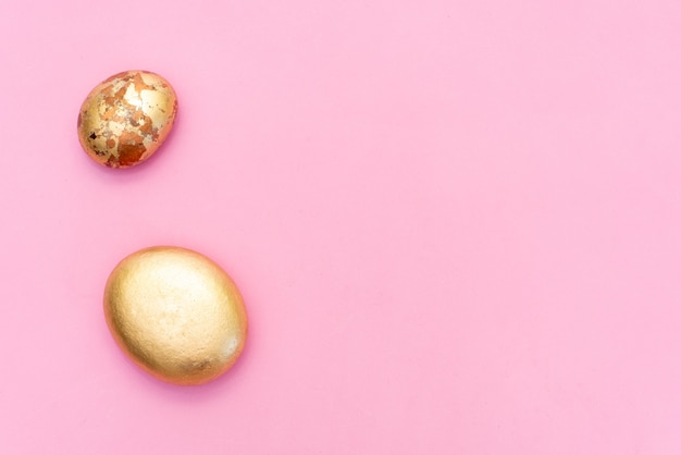 Gold stones and dried flowers on a pink background. spa background and gold leaf.
