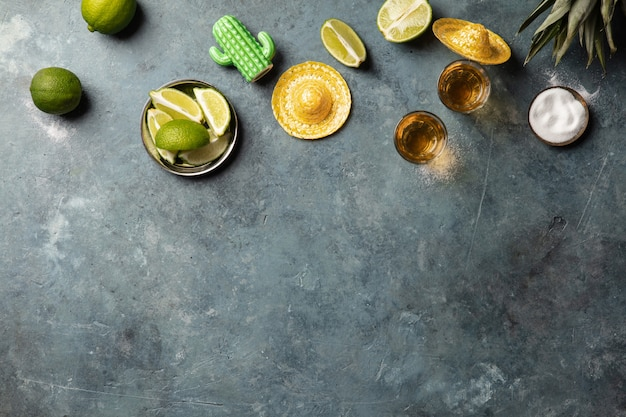 Gold tequila with lime and salt, flat lay