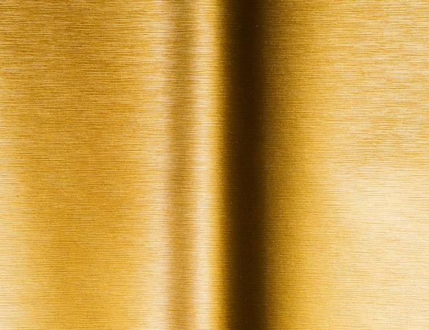 ゴールドのテクスチャ背景と影付きの線