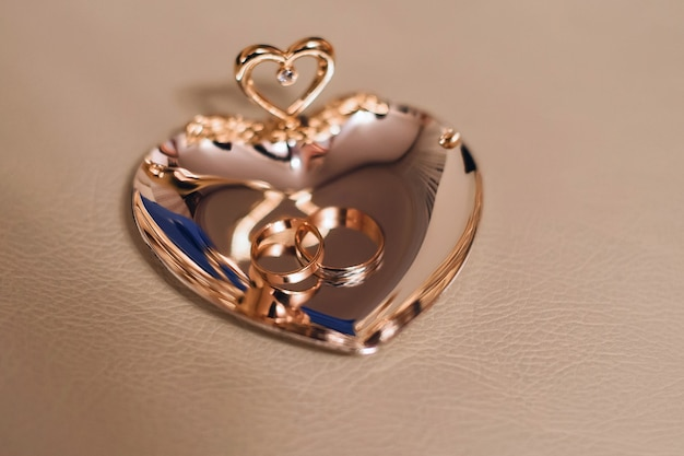 Gold traditional wedding rings on a beautiful stand
