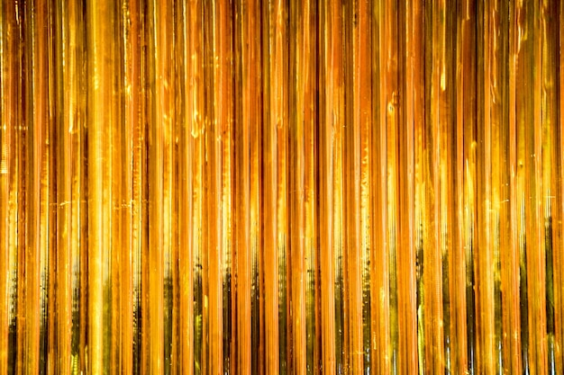 Gold vertical pipe line pattern background wallpaper indoor decoration in some place in thailand.