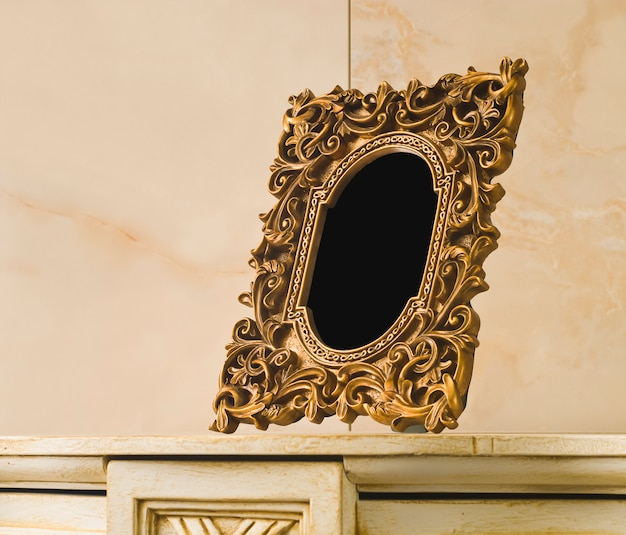 Gold vintage frame on a stone board