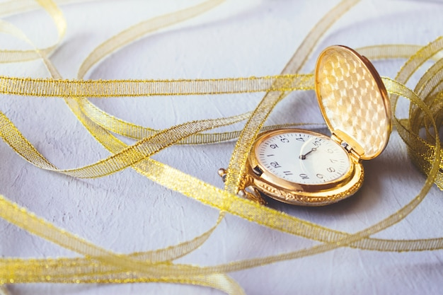 Gold vintage pocket watch with gold ribbon