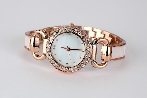 Gold watch with rhinestones .